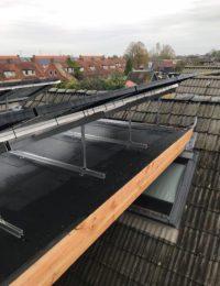 Zonnepanelen op plat bitumen dak